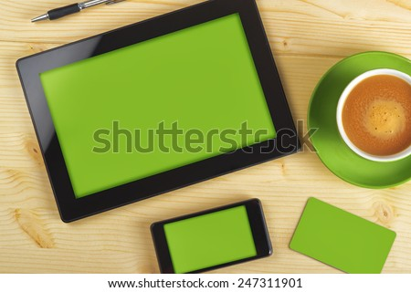 Tablet Computer, Mobile Phone And Business Card with Green Background as Copy Space for Corporate Identity Mock up on Office Table. - stock photo