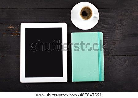 tablet computer, notebook and coffee cup