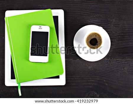 tablet computer, notebook, mobile phone and coffee cup - stock photo