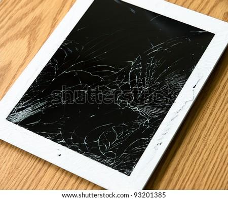 Tablet computer with broken screen - stock photo