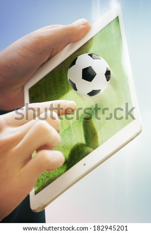 tablet computer with field and soccer ball on it - stock photo