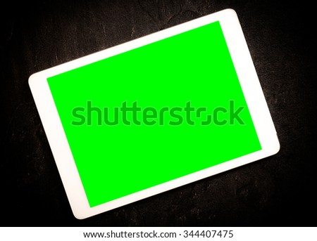 Tablet computer with green screen  - stock photo
