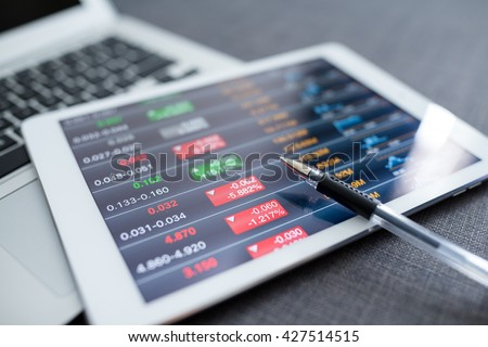 Tablet computer with stock exchange data - stock photo