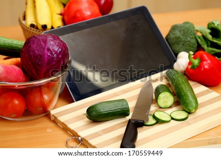 Tablet computer with vegetables  - stock photo
