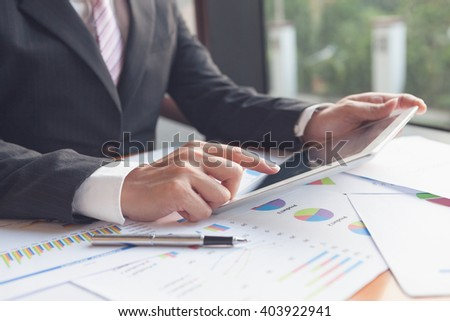 Tablet conference. Professional businessmen using tablet meeting VDO conference for product and marketing restructure / Focus touchscreen to tablet for conference. - stock photo