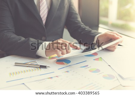 Tablet conference. Professional businessmen using tablet to making telephone conference for product and marketing restructure / Focus on touchscreen tablet for conference. - stock photo