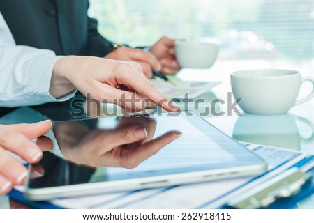 Tablet. Image of male hands with digital tablet touching its screen  - stock photo