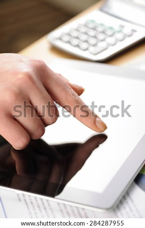 tablet in hand - stock photo