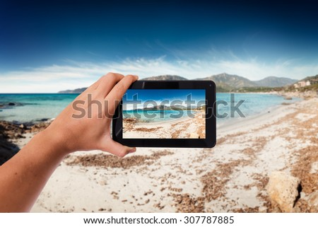 Tablet in hand photo shooting seascape on the beach -  these are all photos made by me, that you separately can find on my shutterstock portfolio. - stock photo