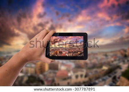Tablet in hand photo shooting sunset landscape - these are all photos made by me, that you separately can find on my shutterstock portfolio. - stock photo