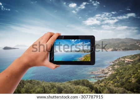 Tablet in hand photo shooting the cost in a sunny day - these are all photos made by me, that you separately can find on my shutterstock portfolio. - stock photo