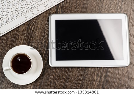 tablet, keyboard, cup of coffee, still life