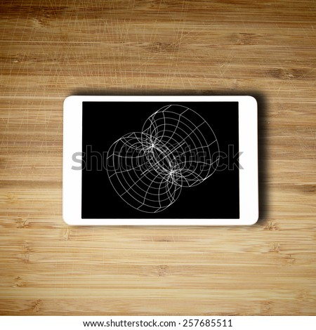 Tablet lying on the table with design on screen - stock photo