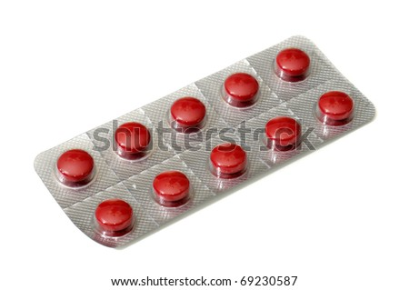 Tablet of red pills isolated in white