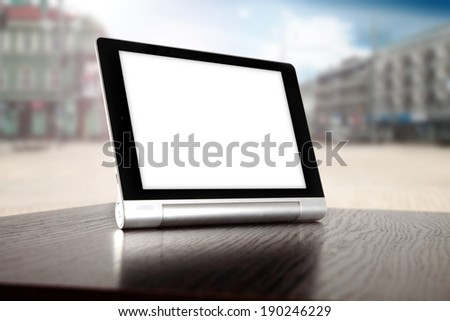 tablet of white space for your photo and city  - stock photo