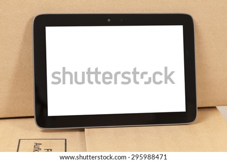 tablet on a moving box - stock photo