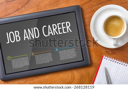Tablet on a wooden desk - Job and Career - stock photo
