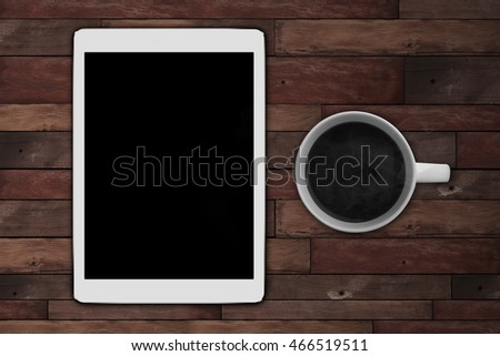 tablet on wooden desk on top view
