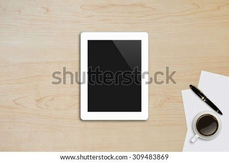 Tablet ,Page paper,Pen,Coffee Cup on wood table background texture with copy space and text space