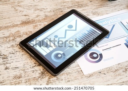 Tablet PC and Business Analytics - stock photo