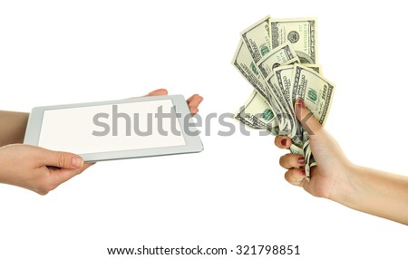 Tablet PC and money on hands- pawnshop concept - stock photo