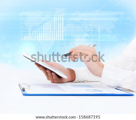 tablet pc business woman finance graph hand touch pad, concept electronic comerce technology internet network over abstract blue background - stock photo