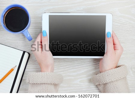 tablet pc computer in hand - stock photo