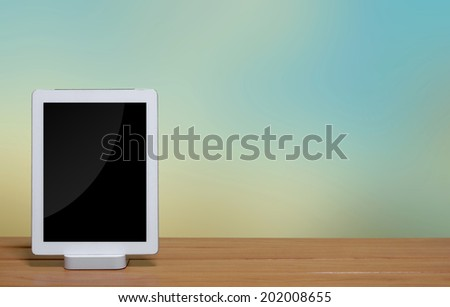 tablet pc computer with dock station on blur background. - stock photo