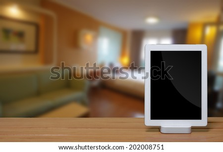 tablet pc computer with dock station on blur bedroom background. - stock photo