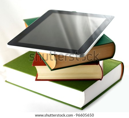tablet pc, ebook reader and books isolated on white background - stock photo