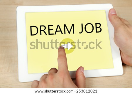 Tablet PC in hands and Dream Job text on screen, Job searching concept - stock photo