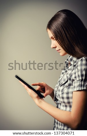 Tablet PC in the hands of a girl - stock photo