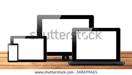 Tablet pc, mobile phone and computer on wooden table background - stock photo