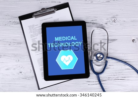 Tablet-pc on doctor table, concept of medical technology - stock photo