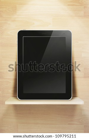tablet pc, on wood shelves and wood wall background - stock photo