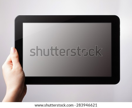 tablet pc with a blank screen in the hands. Business, technology, internet concept. - stock photo