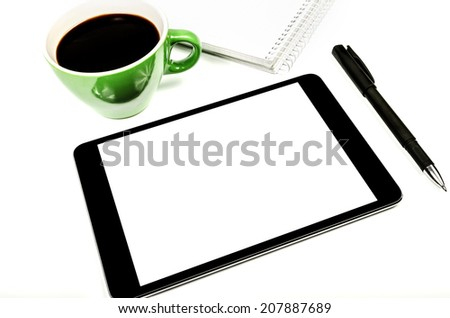 Tablet pc with an empty screen on the white table - stock photo