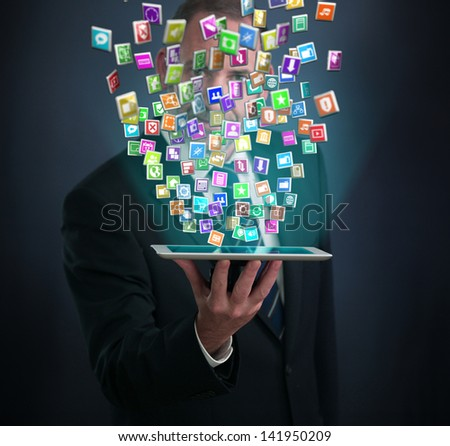 Tablet PC with cloud of application icons - stock photo