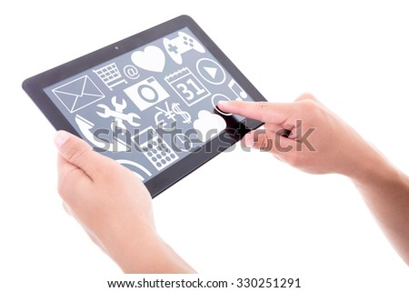 tablet pc with different media applications in male hands isolated on white background - stock photo