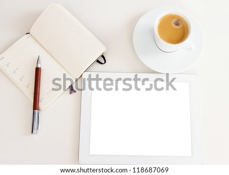 tablet pc with open notebook and cup of coffee - stock photo