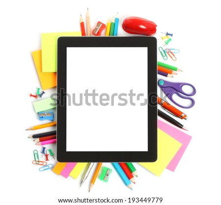 Tablet PC with school office supplies on white background  - stock photo