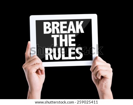 Tablet pc with text Break the Rules isolated on black background - stock photo