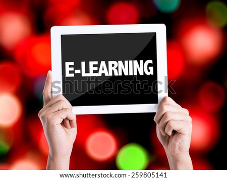 Tablet pc with text E-Learning with bokeh background  - stock photo
