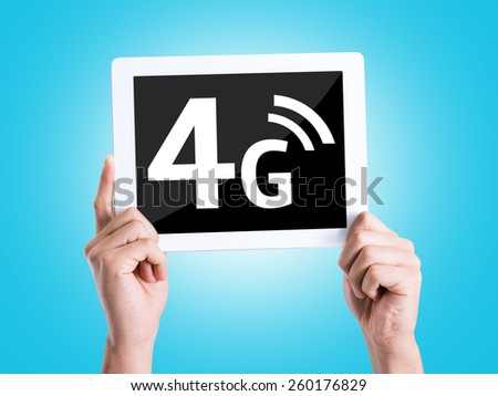Tablet pc with text 4G with blue background - stock photo