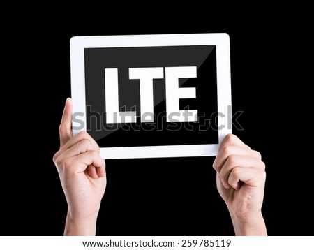 Tablet pc with text LTE isolated on black background - stock photo