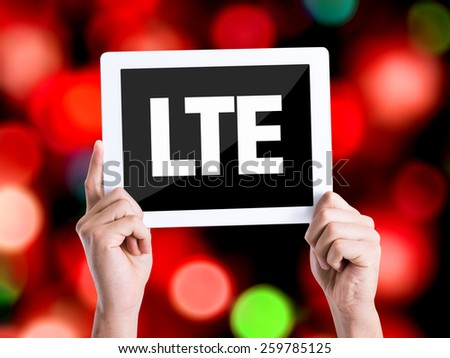 Tablet pc with text LTE with bokeh background  - stock photo