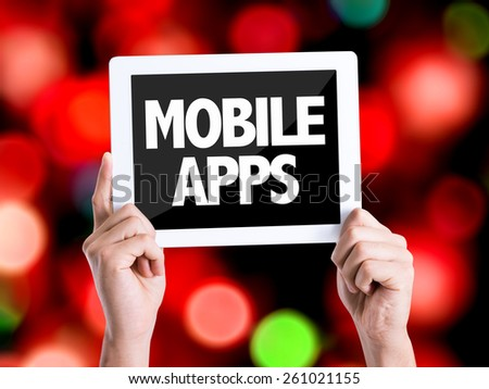 Tablet pc with text Mobile Apps with bokeh background - stock photo