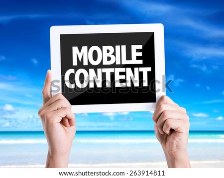 Tablet pc with text Mobile Content with beach background - stock photo