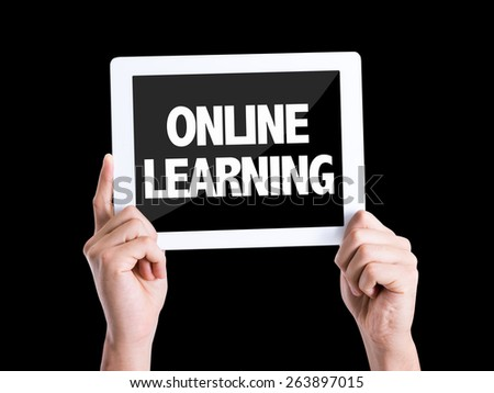 Tablet pc with text Online Learning isolated on black background - stock photo