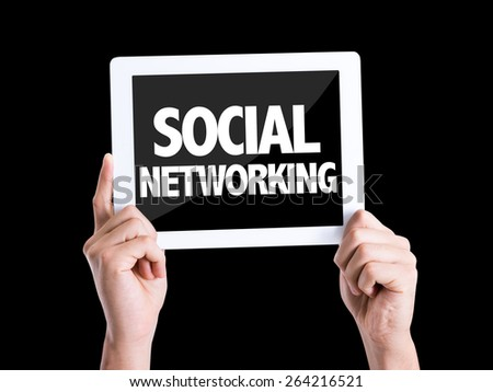 Tablet pc with text Social Networking isolated on black background - stock photo